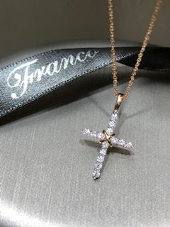 18ct rose gold claw set diamond cross pendant. AJ0.18