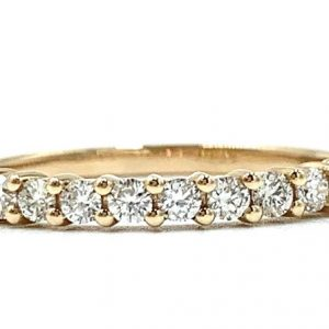 18ct rose gold claw set wedding ring , set with 13 diamonds at total diamond weight of 0.38pts