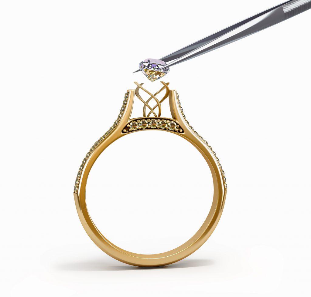 tweezers inserts diamond into ring